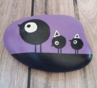 Artistically Hand Painted Pebble Reflecting Birds On Purple Stone