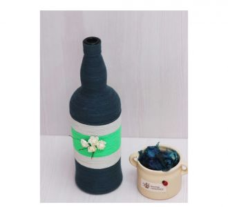 Captivating Hand Crafted Yarn Bottle Vase Representing Dull Blue And White Flowers